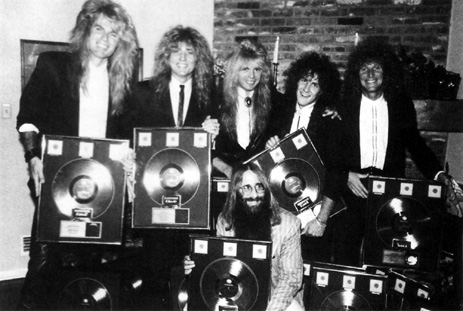 Adrian Vandenberg, David Coverdale, Rudy Sarzo, Vivian Cambpell, Tommy Aldridge &  JDK celebrating the Triple Platinum status of Whitesnakes' record - Los Angeles, CA - December  5th, 1987