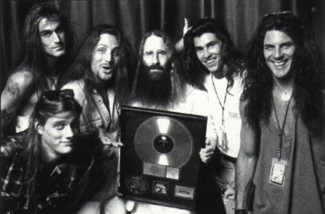 Jackyl with JDK.  l-r: Jimmy Stiff, Chris Worley, Jesse James Dupree, JDK, Jeff Worley & Tom Bettini accepting their Gold Record for Jackyl - Los Angeles, CA - 1993
