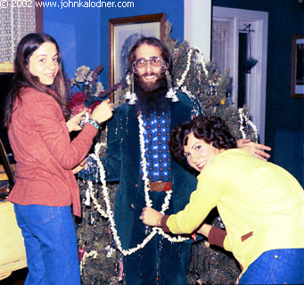 Marcy Kolbach & Emma Smith decorating JDK as a Christmas Tree (*photo taken by Rob Hyman of The Hooters) - Christmas 1973