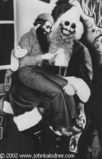 JDK sitting on himself dressed as Santa Actually a Christmas Card that JDK sent out in 1979